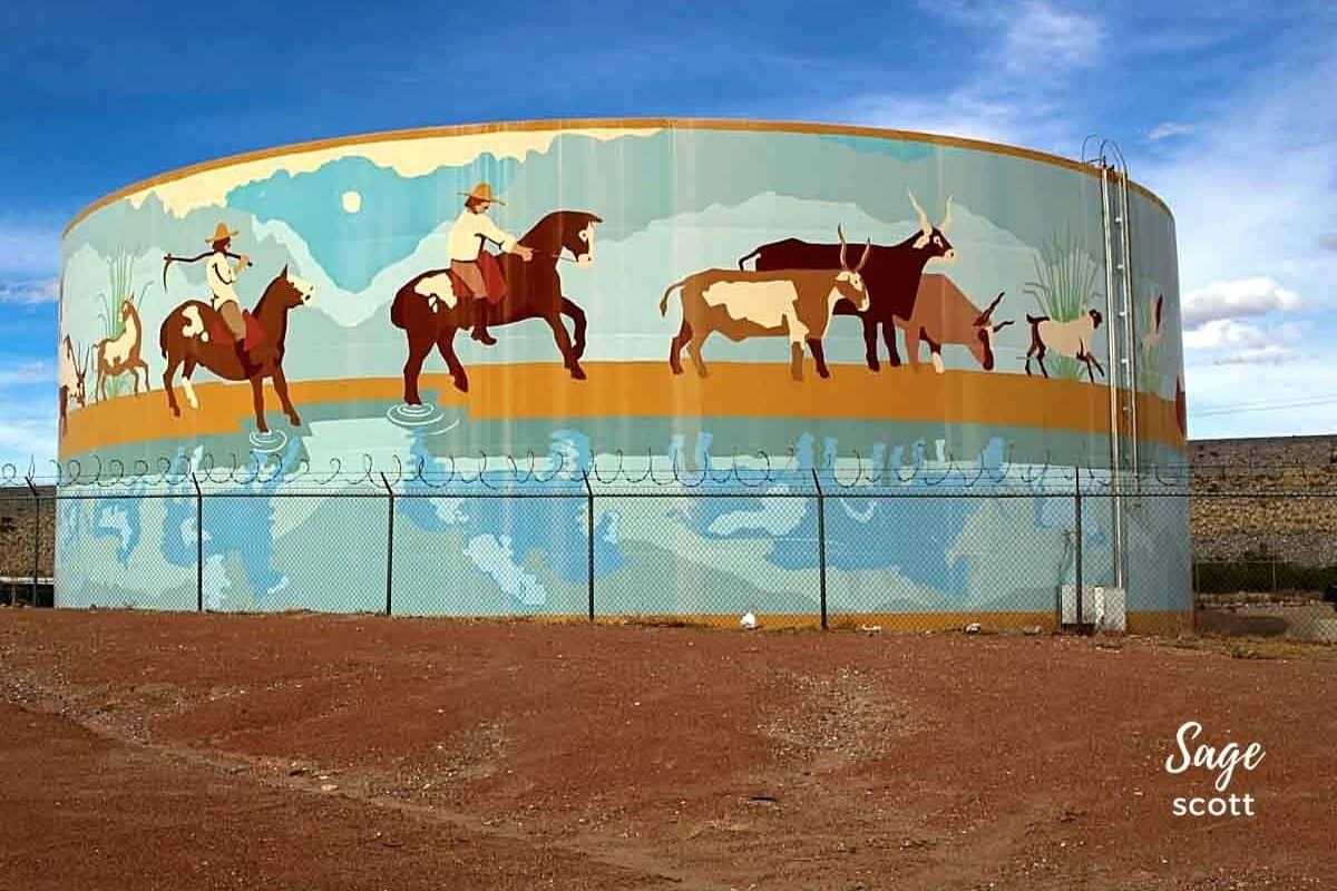 Horses run along the Rio Grande in this water tank mural