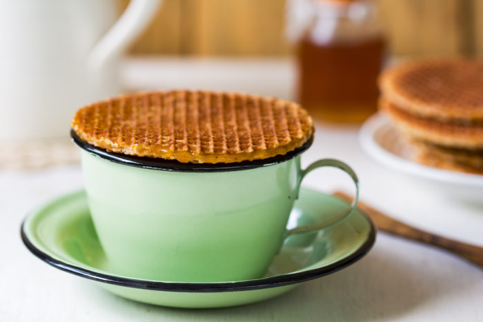 A stroopwafel is a Dutch treat that connects two thin waffle wafers with caramel syrup