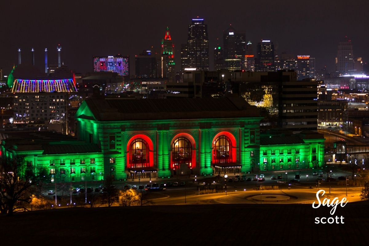 Union Station lit in red and green lights for the holidays