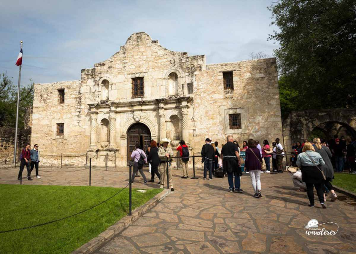 Visitors walk toward the entrance of the Alamo