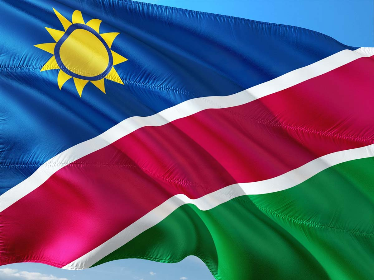 Namibia has a sun flag with a sun in the left corner.
