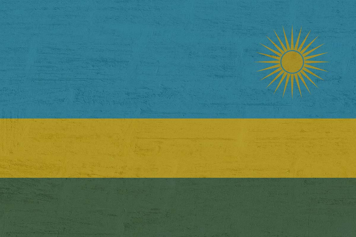 Rwanda has a triband flag with a yellow sun in the corner.