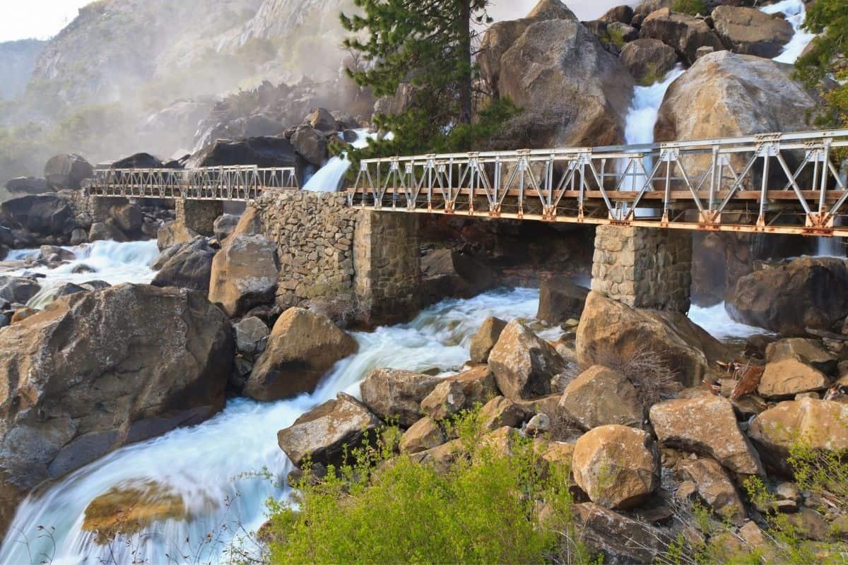 Wapama Falls flowing under a footbridge at Yosemite