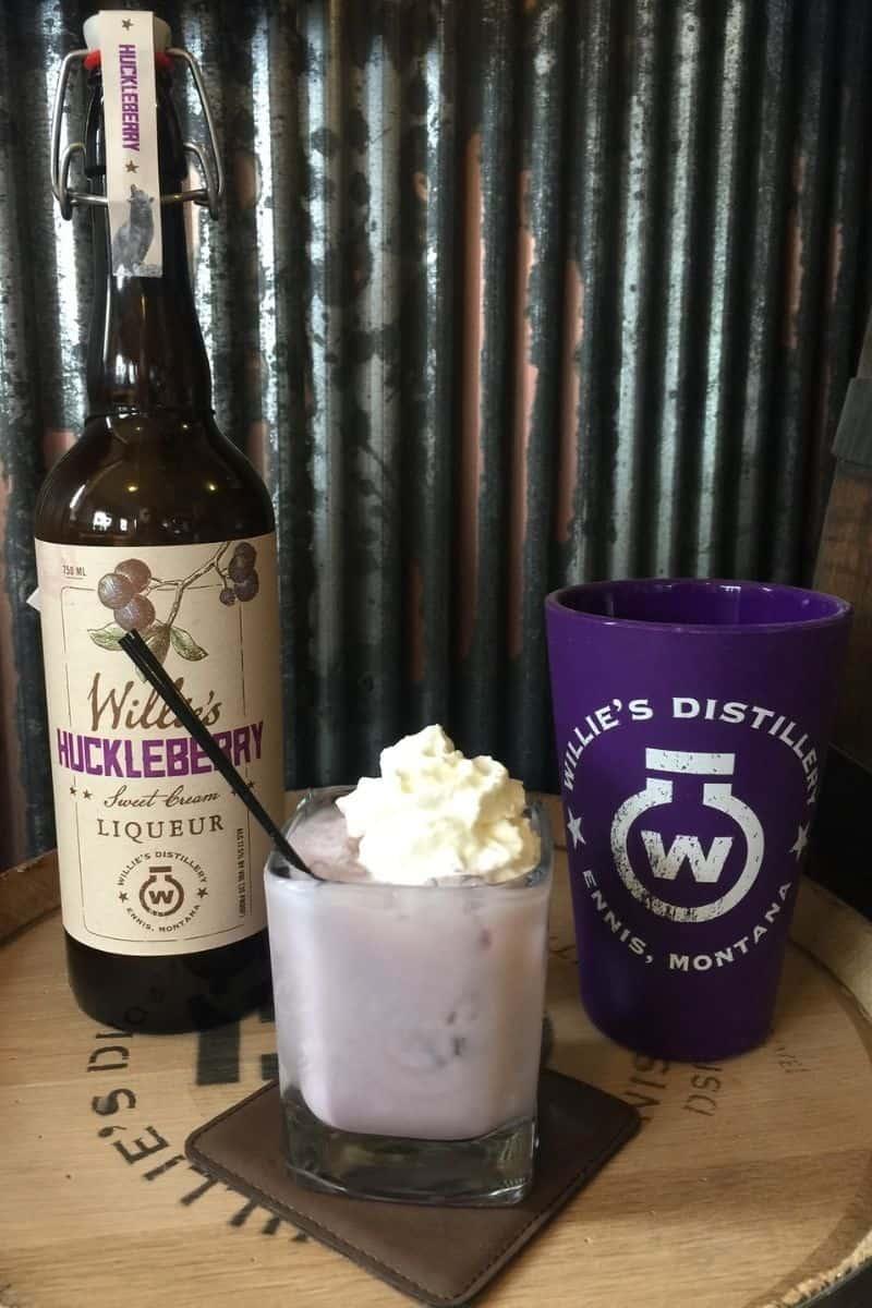 Bottle of huckleberry cream liqueur mixed into a cocktail