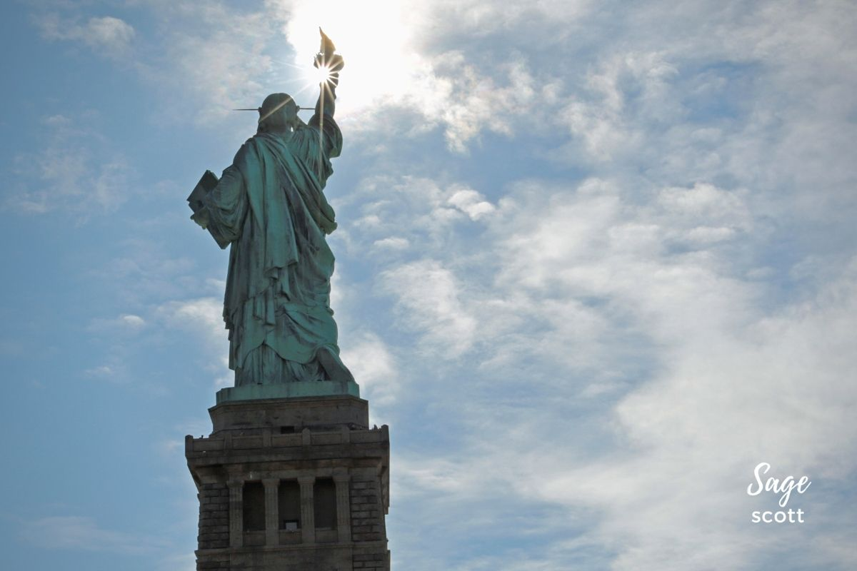 Statue of Liberty with light reflecting in torch